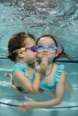 Sisters Swimming Underwater