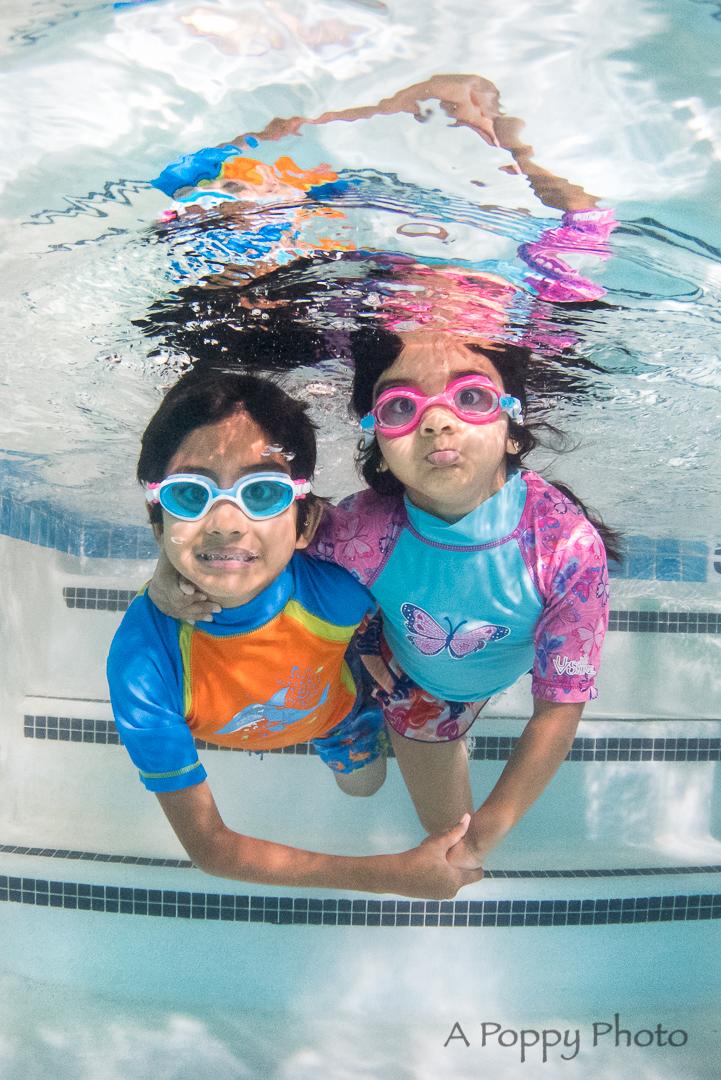 siblings swimming underwater