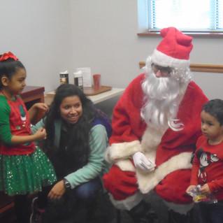 Santa with happy family.jpg