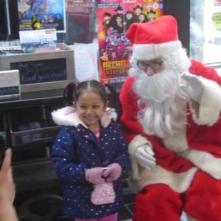 happy kid with santa.jpg