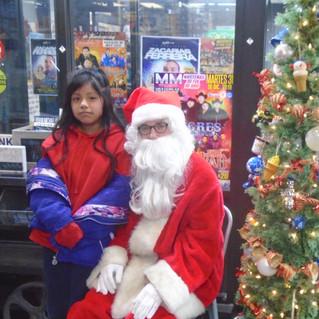 Santa with girl customer.jpg