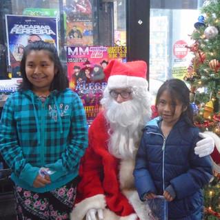 sisters with santa.jpg
