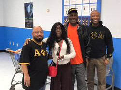 Being a blessing to our community this Holiday Season...SGL and Alpha Impact Charitable Foundation P