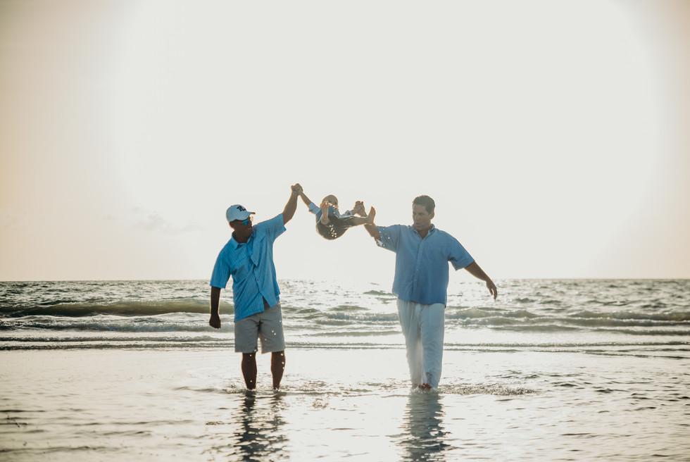 Grandpa and Dad swinging him
