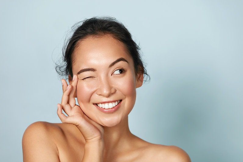 Skin care. Woman with beauty face touchi