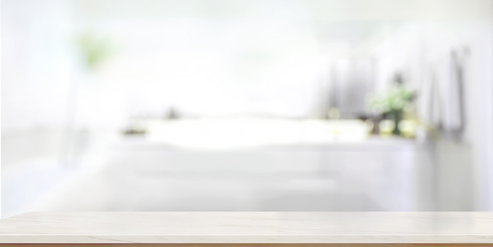 Empty marble top table with blurred bath