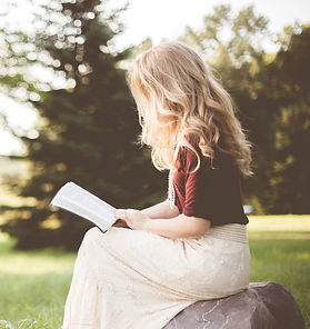 woman%20sitting%20while%20reading%20book