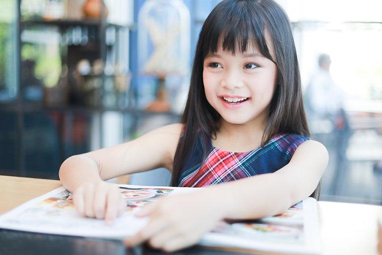 asian-little-girl-reading-book-smile-hap