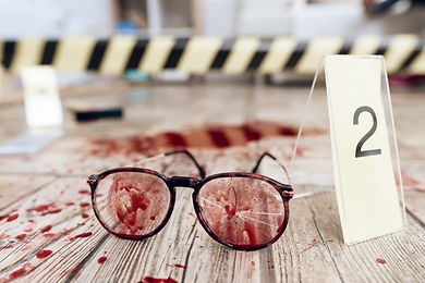 close-up-blood-stained-glasses-crime-sce