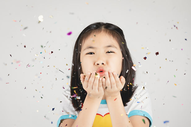 asian-girl-having-fun-with-colorful-conf