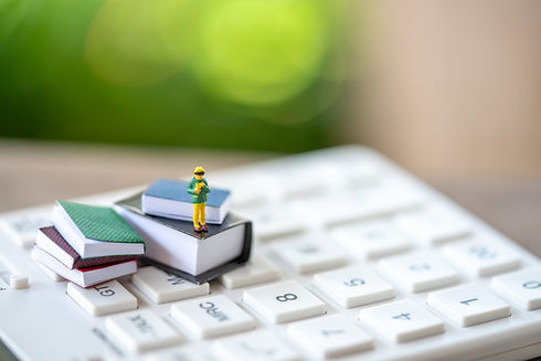 little-kids-miniature-people-standing-books-white-calculator.jpg