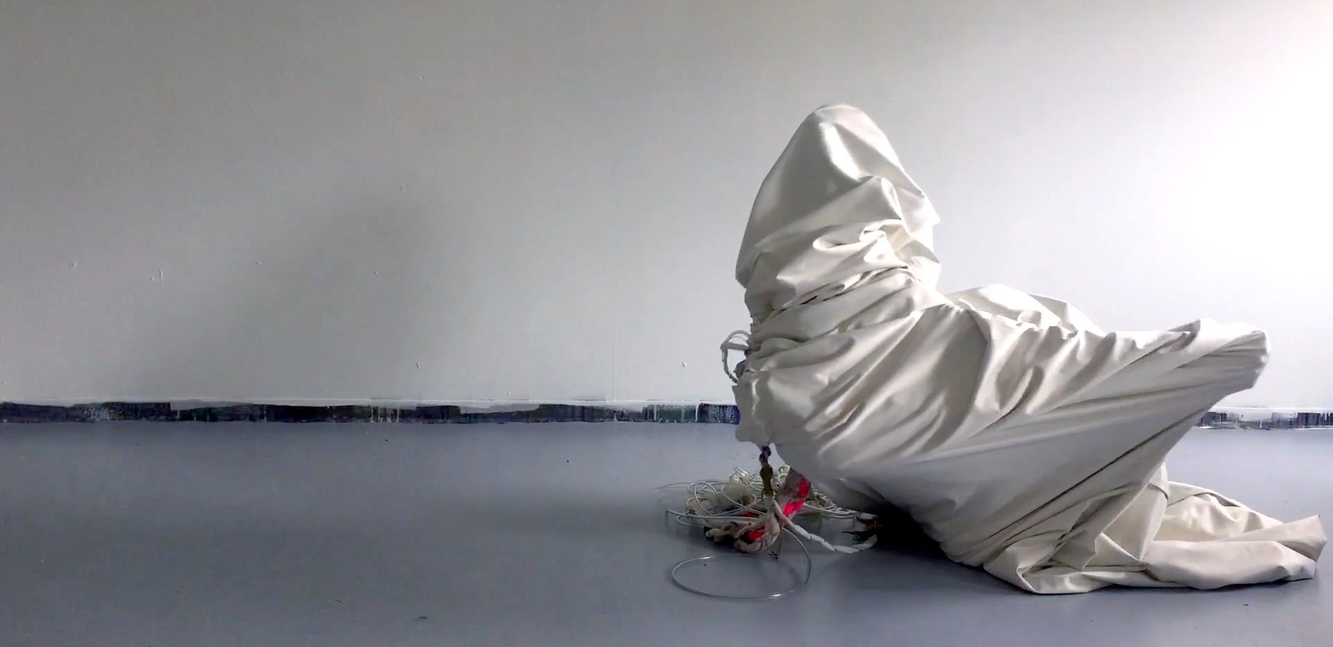 "5.	Breathe, video still,   View Breathe and Earth/Body, video excerpts, 1:56  Breathe was performed at Roman Susan Gallery, 2018, Earth/Body, 2017 are movement tests using the cloth from ""Returned"", performed for video and nature."