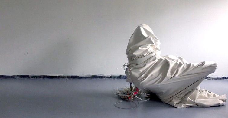 """5.Breathe, video still,   View Breathe and Earth/Body, video excerpts, 1:56  Breathe was performed at Roman Susan Gallery, 2018, Earth/Body, 2017 are movement tests using the cloth from """"Returned"""", performed for video and nature."""