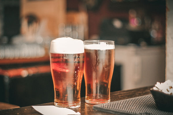 depth-of-field-photo-of-two-pilsner-glas