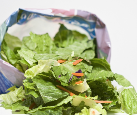 Open salad bag, leaves falling out