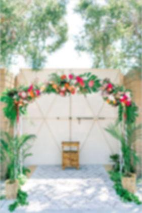 tropical-wedding-theme-arch-ceremony.jpg