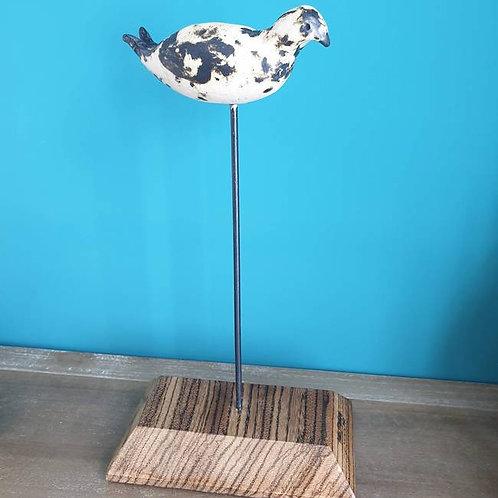 Keramiek vogel op houten voet