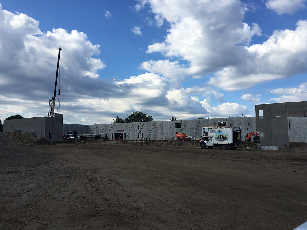 EH Design Blog - Commercial Project - RTL - Exterior Precast Walls Going up - Full front View of Building