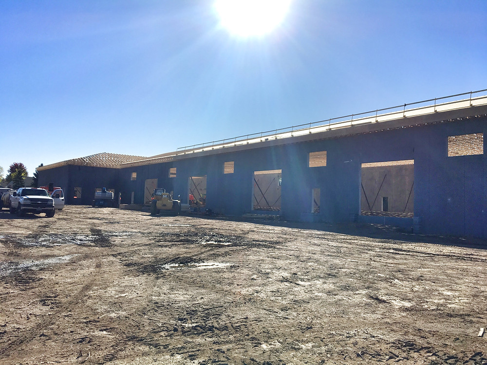 EH Design Blog - Commercial Project - RTL - Roofing Trusses going up  - Interior View of Trusses  - Trusses are all up