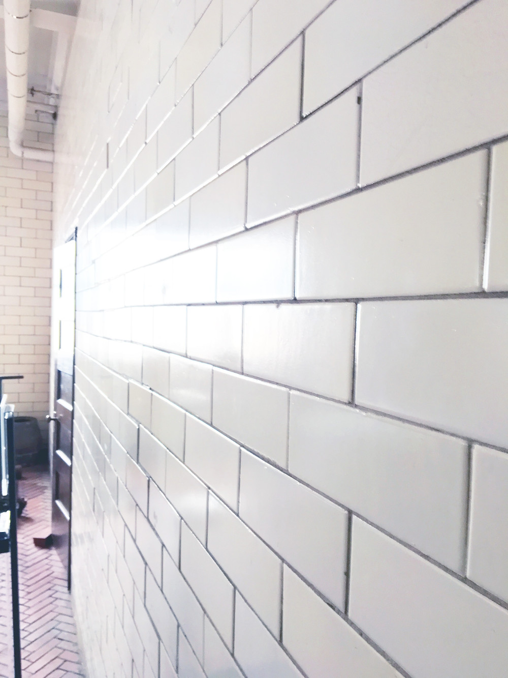 EH Design Blog - Carriage House of the white large subway tile from floor to ceiling