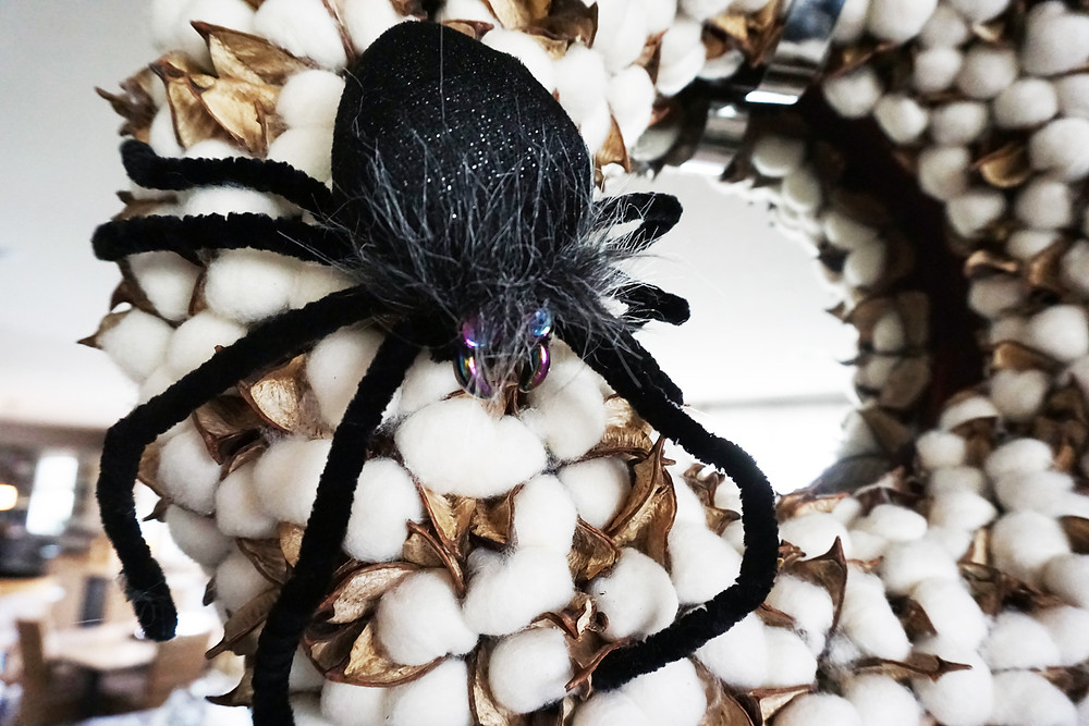 EH Design Blog - Halloween Decorations - Close up of black spider on cottonwood wreath
