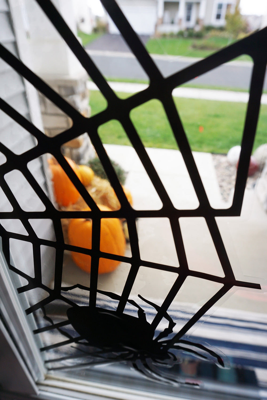 EH Design Blog - Halloween Decorations - close up of spider web window decals