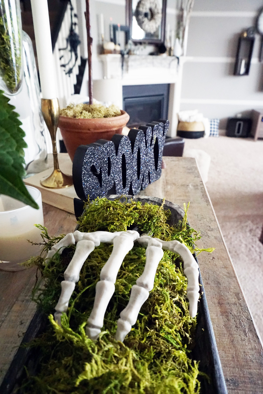 EH Design Blog - Halloween Decorations - Close up of skeleton hand and spooky