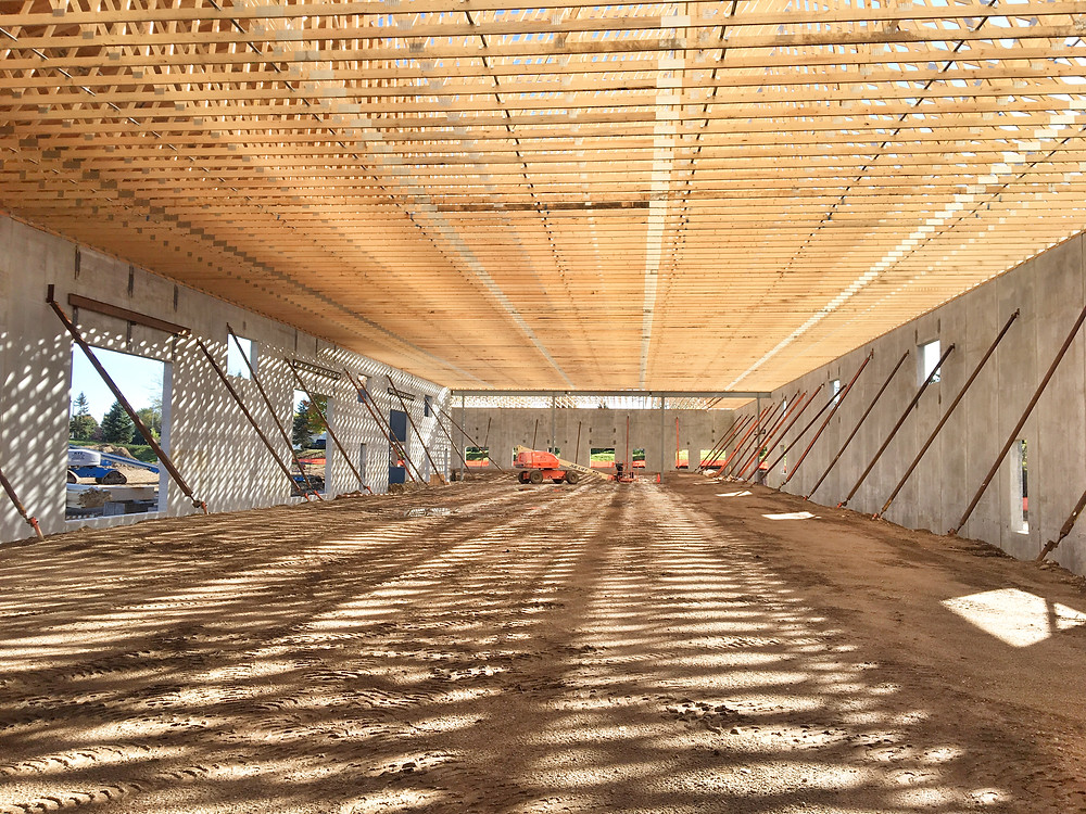 EH Design Blog - Commercial Project - RTL - Roofing Trusses going up  - Interior View of Trusses  - Full Length of Building