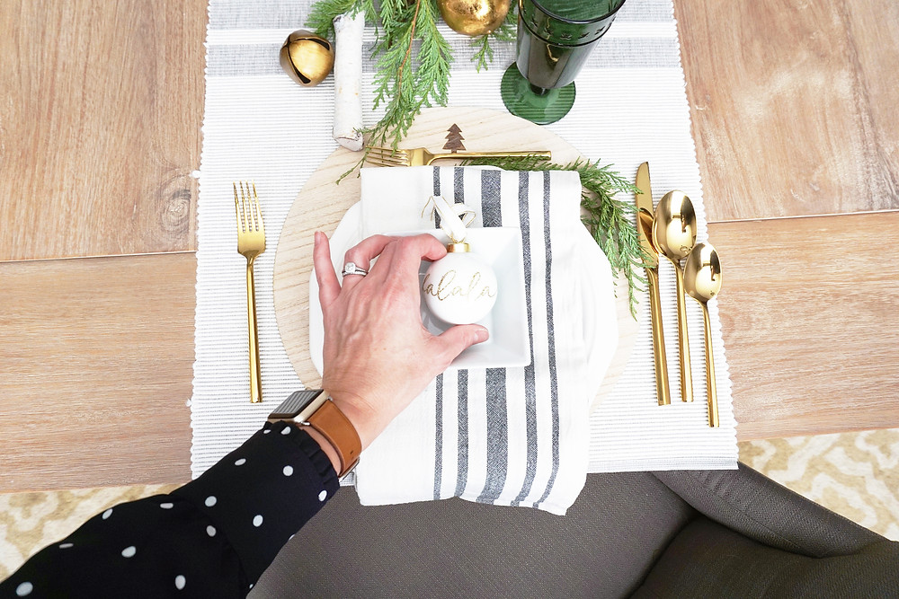EH Design Blog - Home for the Holidays 2017 Christmas Tour - Erin Haugerud Setting Table with Ornament in Dining Room