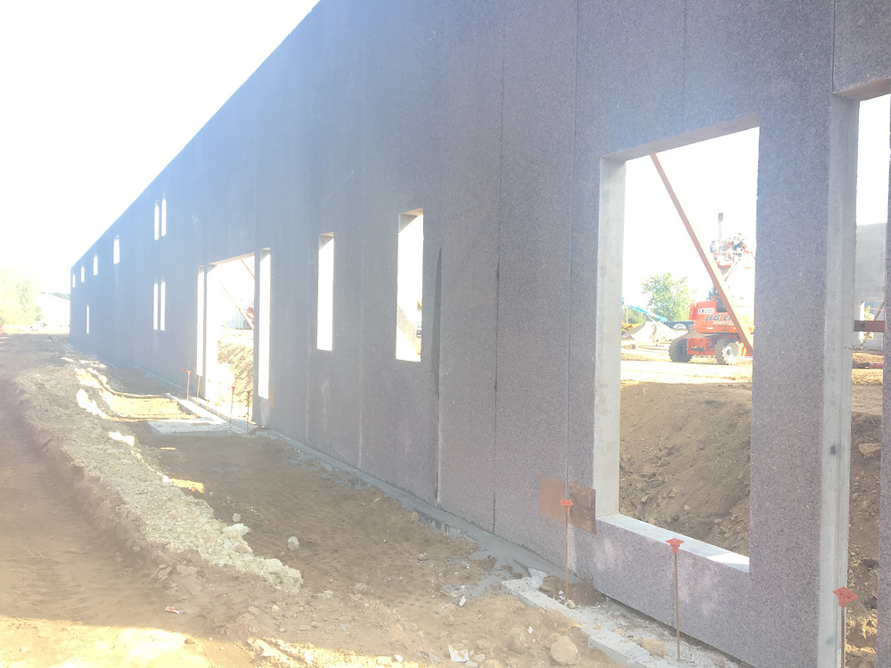 EH Design Blog - Commercial Project - RTL - Exterior Precast Walls Going up - Back of Building