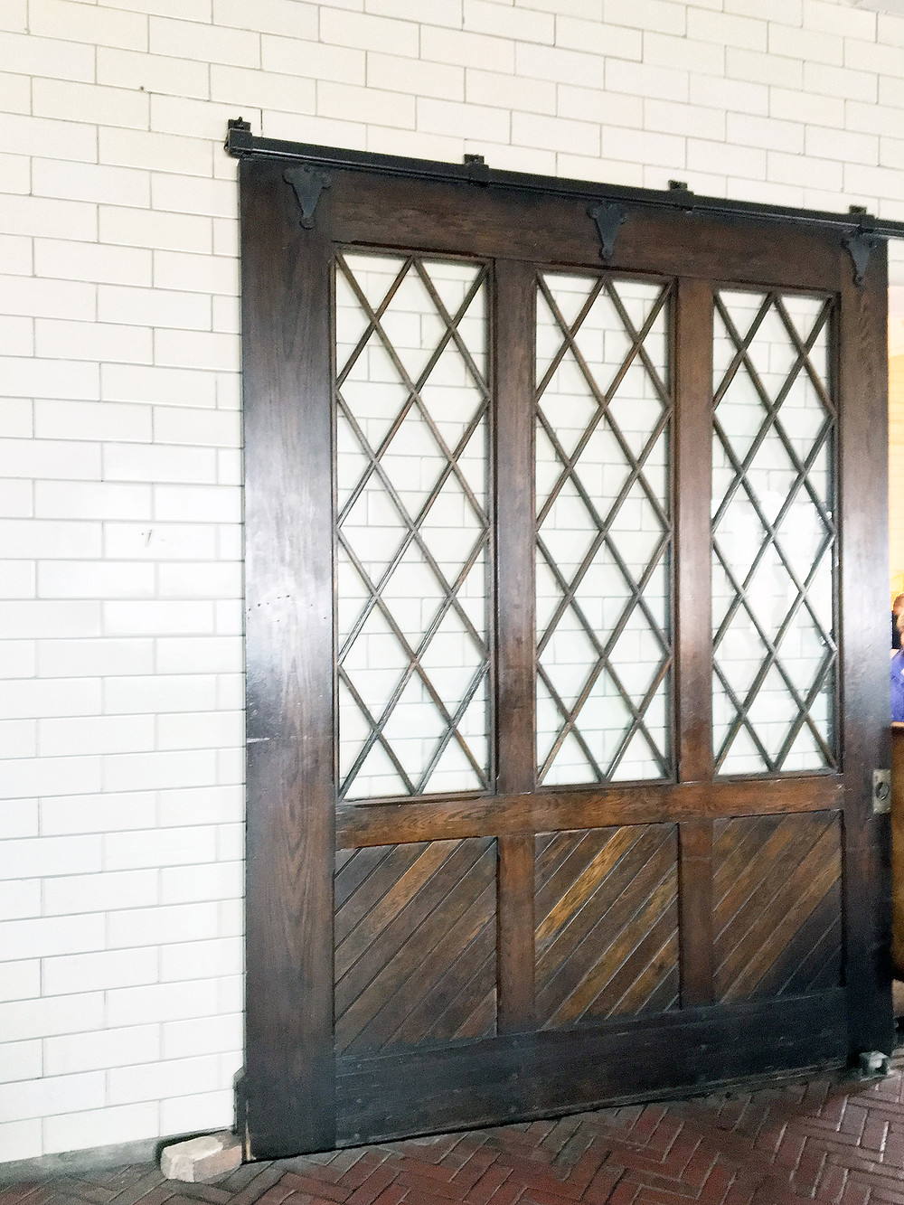 EH Design Blog - Carriage House of the glass and wood doors separating the carriages from the horses