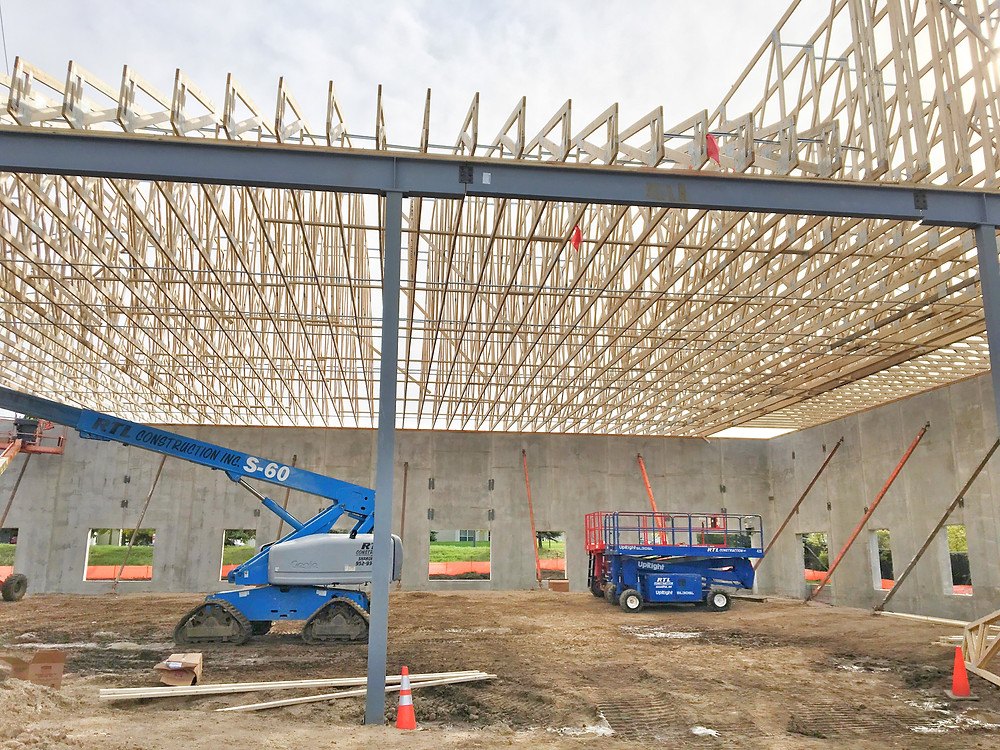 EH Design Blog - Commercial Project - RTL - Roofing Trusses going up  - Interior View of Trusses