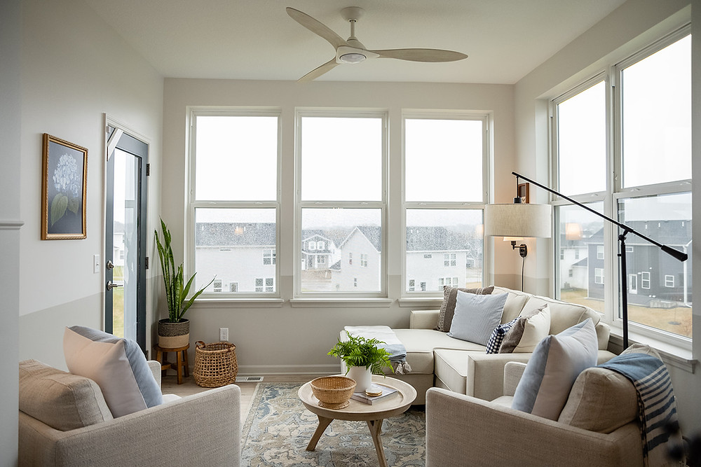 sunroom with sofa and chairs