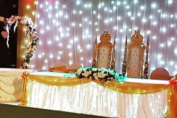 Head table and cake stage with lots of s