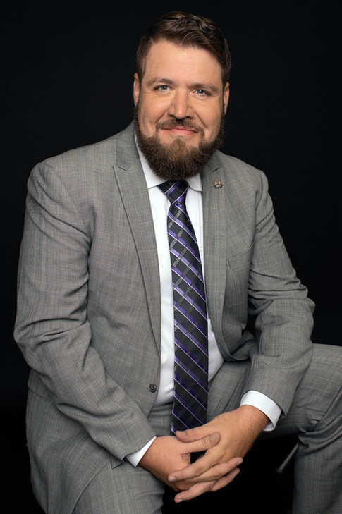 gentleman in gray suit