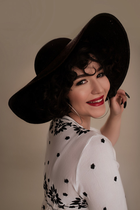 model in Black Hat
