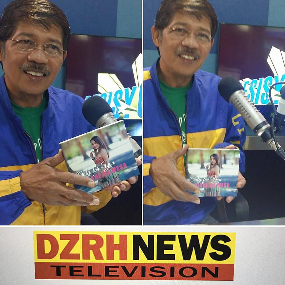 "Andy Verde of DZRH holding Diane de Mesa's ""Only for you"" album!"
