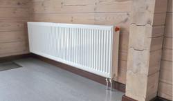 Радиатор отопления в деревянном доме