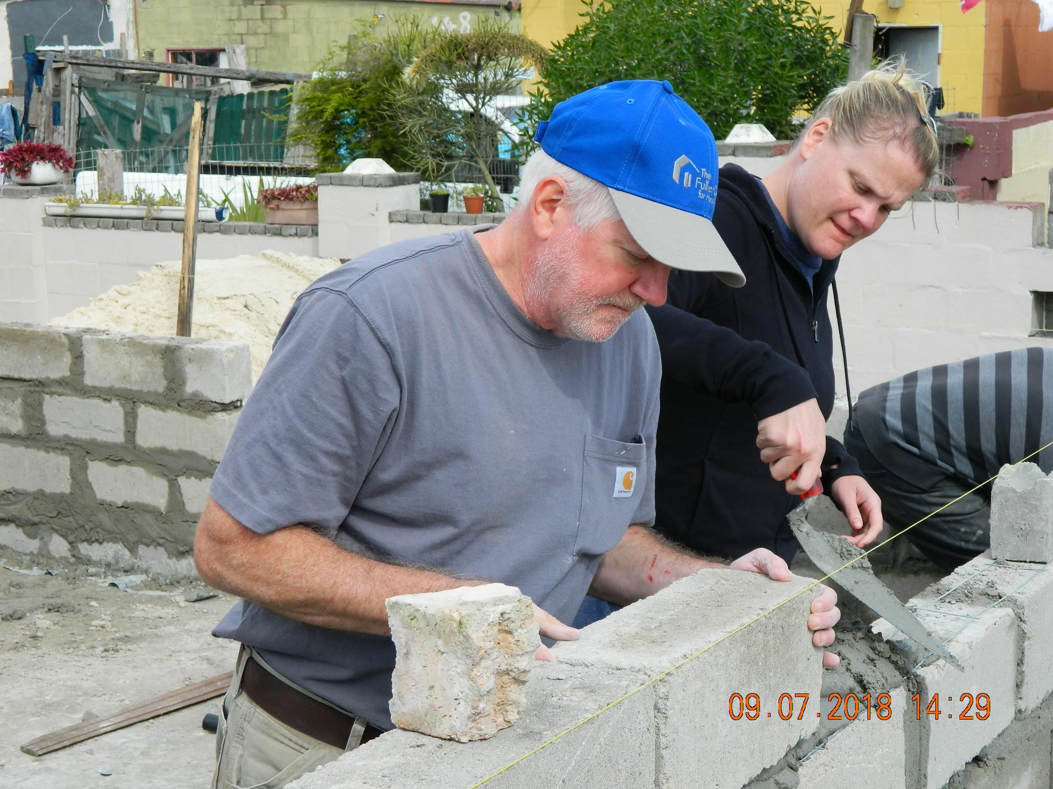 Bob guides Beth in block work