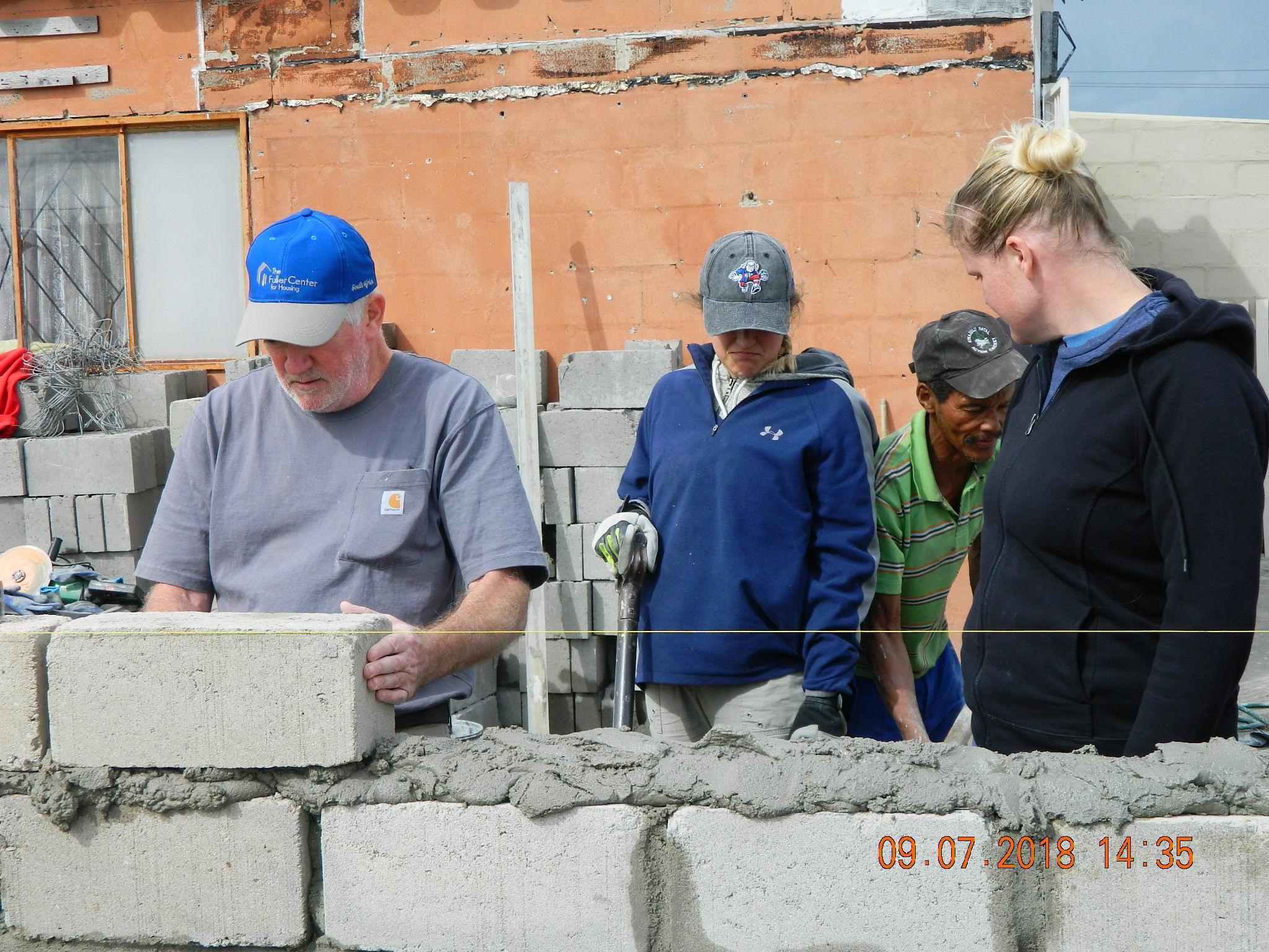 Bob lays cement blocks