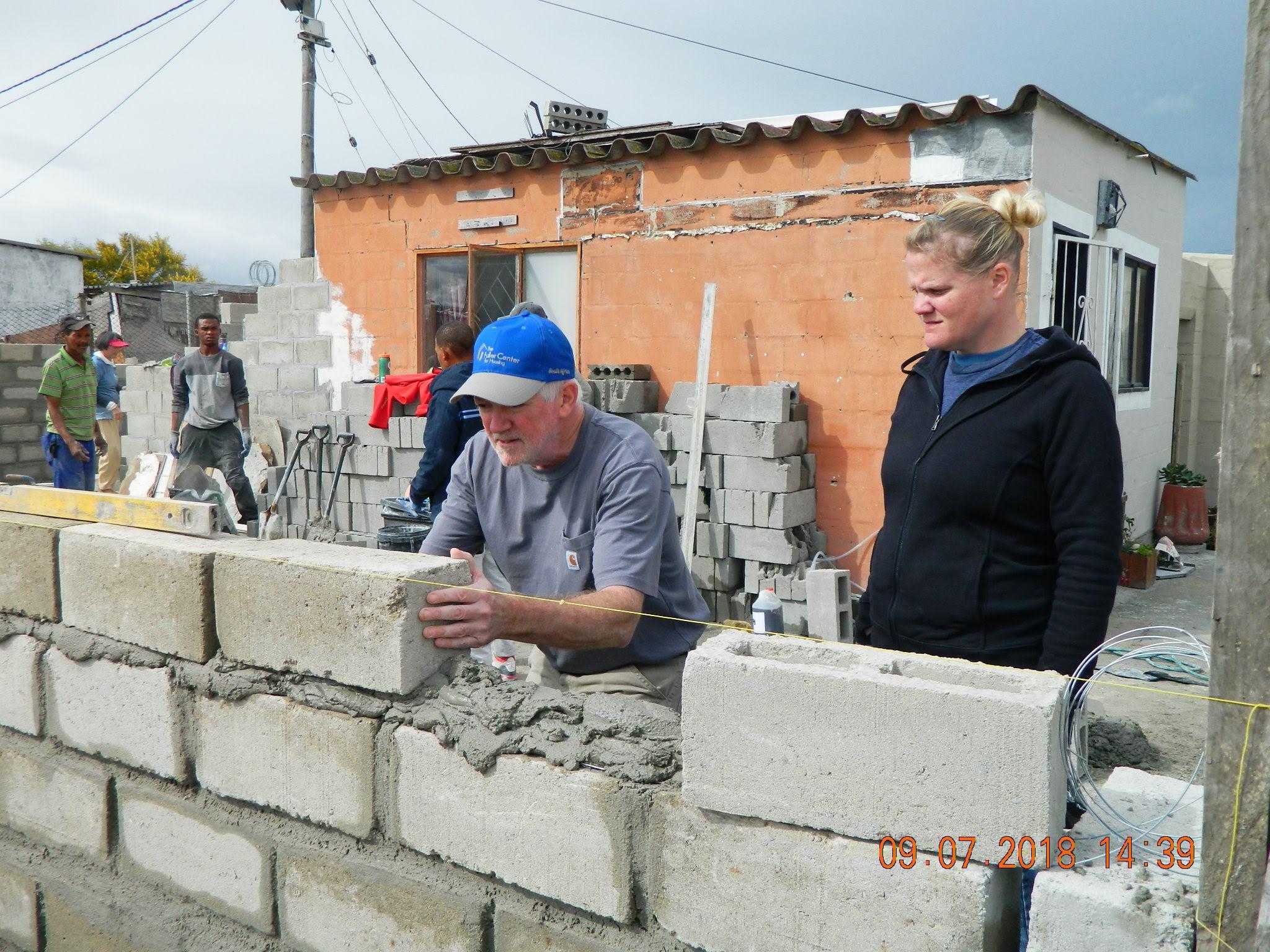Bob lays bricks while Beth learns