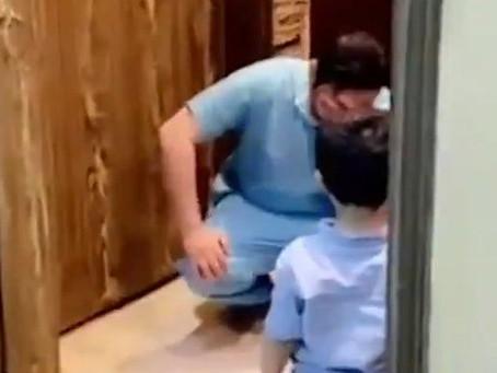 Enfermeiro se desespera por não poder abraçar o filho durante a pandemia de COVID-19