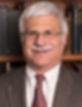 Photograph of a smiling Professor Robert Destro of the Catholic University Law School.