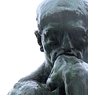 "close up of Rodin's sculpture, ""The Thinker."""