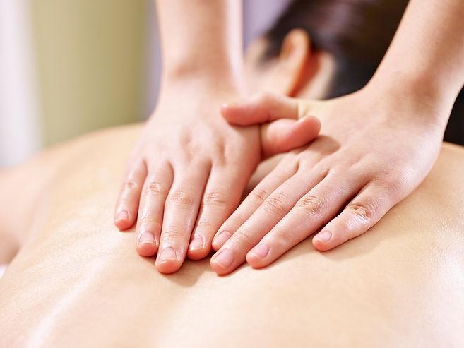 close-up of hands of a masseur massaging