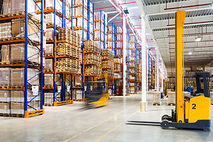 Large modern warehouse with forklifts.jp