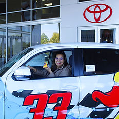 A very Happy Jennifer Musick drives away in her brand new Toyota Tacoma SR5 dbl cab truck!