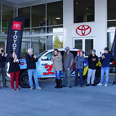 Rotarians along with General Manager Carmen Marquart celebrate the winner of the 2021 Grand Prize Toyota Tacoma SR5 - Jennifer Musick of Kennewick.