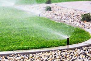 Automatic sprinklers watering grass.jpg