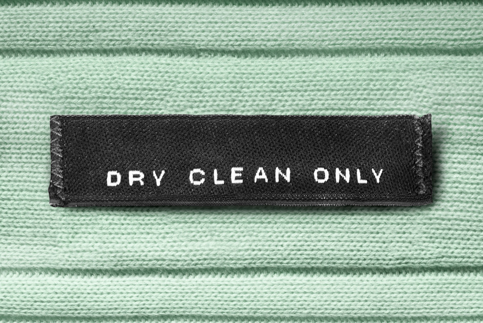 Clothes label lettered dry clean only on